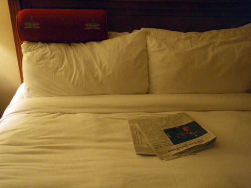 Bed with Newspaper - Hote Room