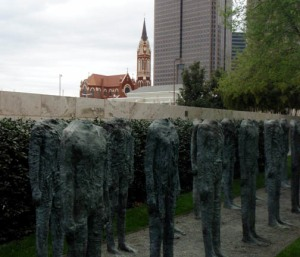 Headless Statues with Church in Background