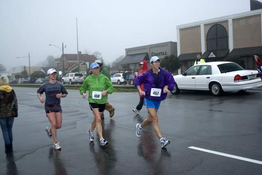 Laurie (green) Susan (Blue Jacket) pushing towards finish line