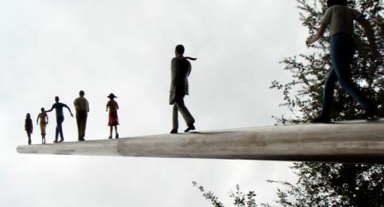 People Walking Up a Pole - Dallas Sculpture Garden