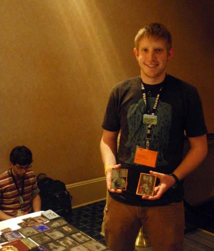 Photo Student Todd Rotkis holding up his Ambrotypes at Print Sharing