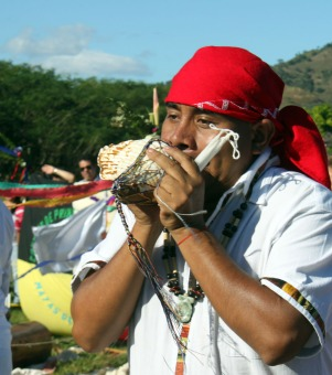 Mayan Priest Blowing into Conch Shell during Ceremony