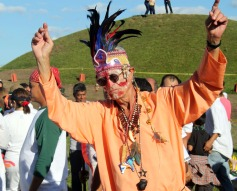 Orange clad dancer with headdress @ Mayan End of World ceremony.