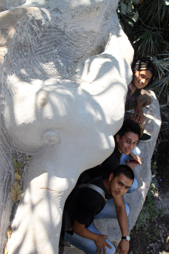 Three of Miguel Angel Ramirez's assistants who carved the sculptural relief behind them in photo.