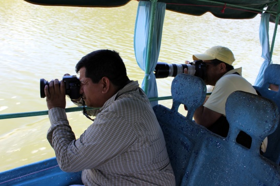 Joel and Juan photographing Egrets from boat.