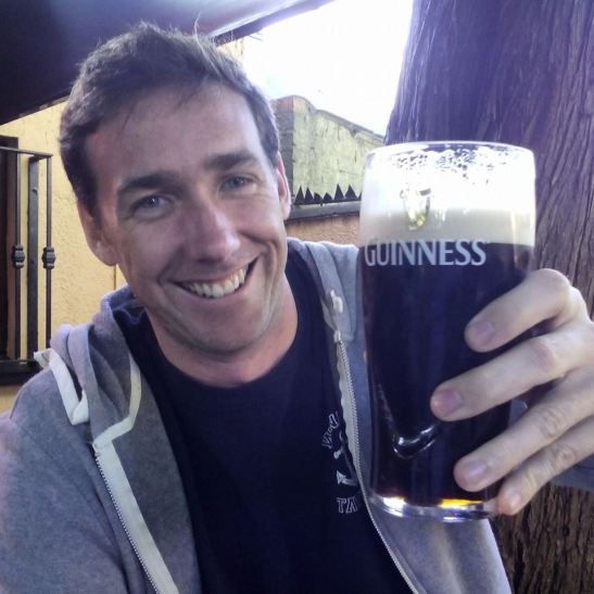 Adam enjoying his first pint of Guinness at Ivy House Pub in Dublin